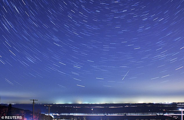A meteor piercing the stars during the annual quadruple meteor showers in Qingdao, Shandong Province, January 4, 2014.